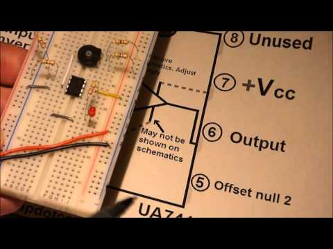How to build 741 op amp IC comparator electronics circuit, split power supply on a breadboard DIY.