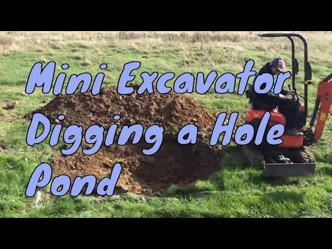 Digging a hole with a mini excavator | Any Pond Limited