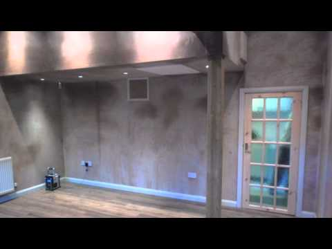 Garage conversion into extra lounge for couples teenage sons