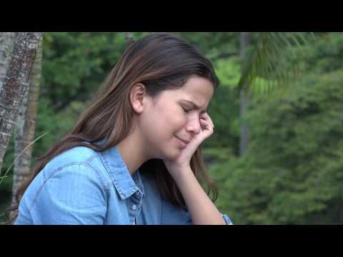 Hispanic Teen Girl Crying With Emotional Pain