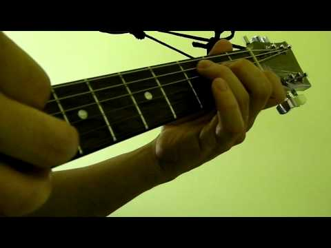 How To Press and Pluck Guitar Strings (Beginner Lesson)