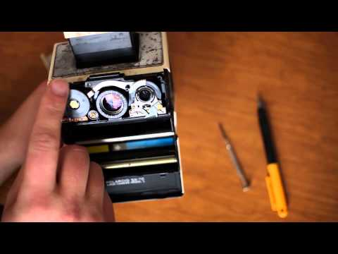 How to remove front cover (aka shutter housing) on a Polaroid SX-70 to fix a stuck/jammed focus.
