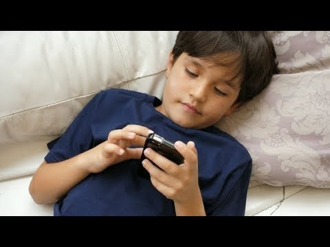 Boy Playing with Cell Phone | Stock Footage
