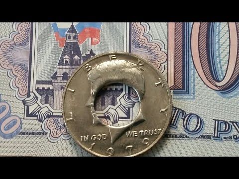 Inexpensive way to get a perfectly centered punch in your coin to make a coin ring