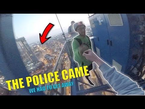 POLICE & SECURITY ESCAPE FROM CRANE CLIMB!