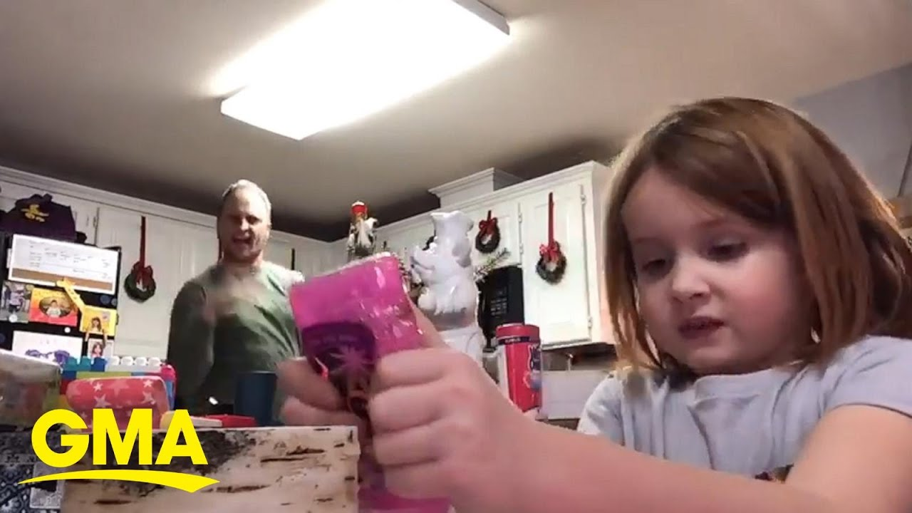 Dad hysterically dances as daughter does arts and crafts for virtual school