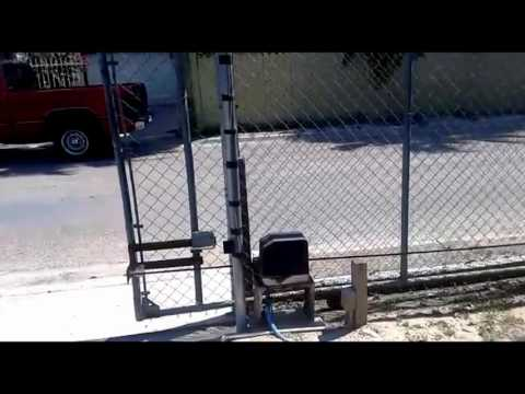 Gate1® Gate opener opening and closing a Chain link gate