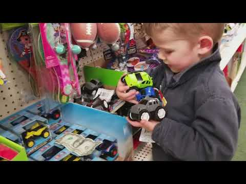 Joshua finding a toy at the dollar store