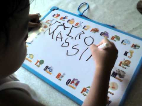 gifted child writing his name at the age of 2