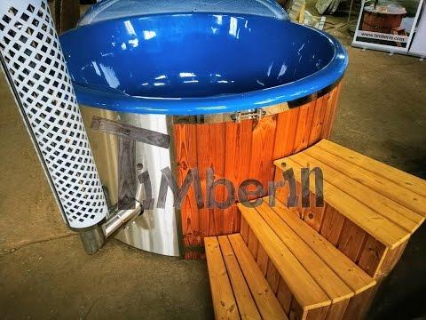 Wood burning hot tub with deep blue fiberglass lining - TimberIN