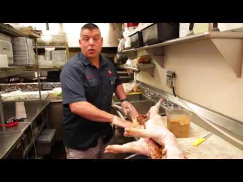 Preparing a pig for a pig roast