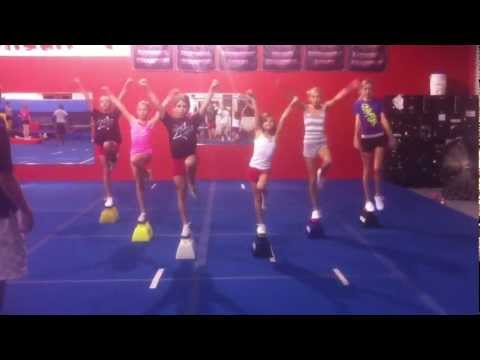 6 Flyers Practicing Liberties on the Cheerleading Stunt Stand