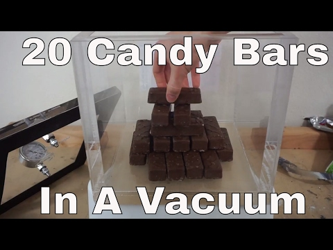 What Happens When You Put 20 Candy Bars In a Huge Vacuum Chamber?