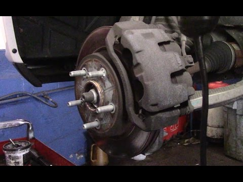 How To Replace The Front Brakes And Rotors On A 2014 Dodge Ram