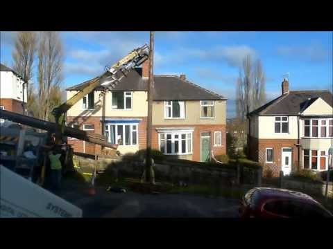 Contractors replacing a telegraph pole in Sheffield