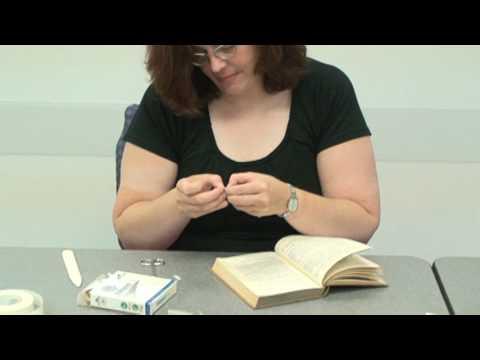 Mending a Book with Book Repair Tape