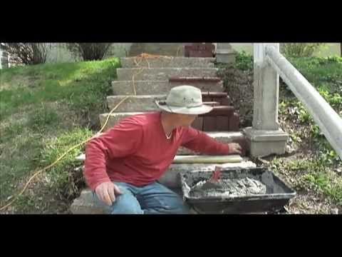Raising an old concrete stairs with bricks.