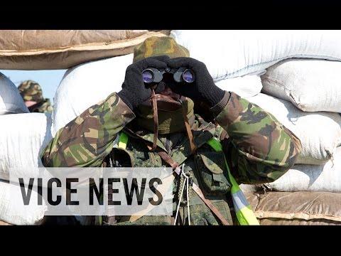 Reporter's Confrontation at Ukrainian Checkpoint: Russian Roulette in Ukraine
