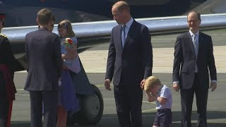 Bless you! Prince George shakes off sneeze as royals are welcomed to Germany