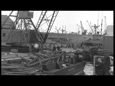 United States soldiers get aboard ship at harbor in France. HD Stock Footage