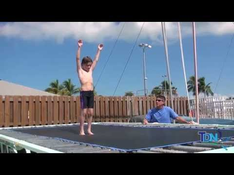 Teaching a Somersault (flip) on the Trampoline.