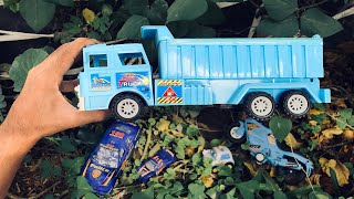 Finding some Blue toy vehicles from the green bushes of an abandoned house - Dump Truck, Police Car