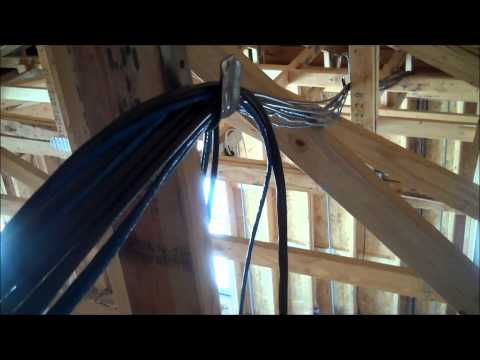 Pulling CCTV wiring through the attic during construction of a home