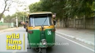 A tuk-tuk or auto rickshaw on the streets of Delhi, India