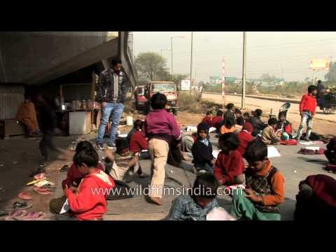 Children attending a free school, run under a metro bridge