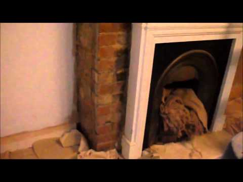 Exposed brick fireplace repointed using lime putty