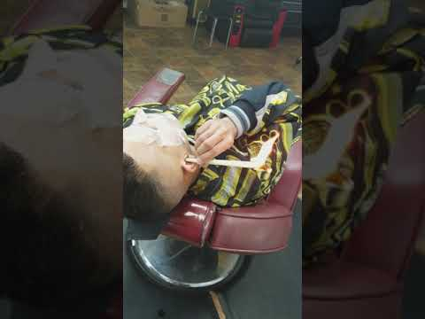 Ear candle wax cleaning Dominican barbershop