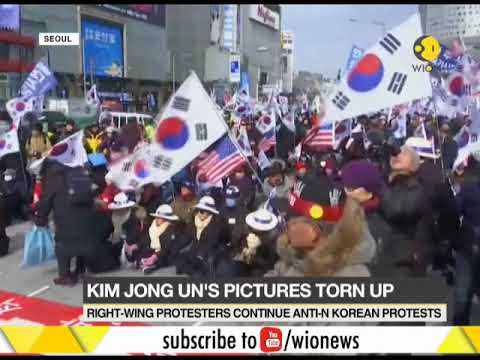 Protests burn North Korean flags