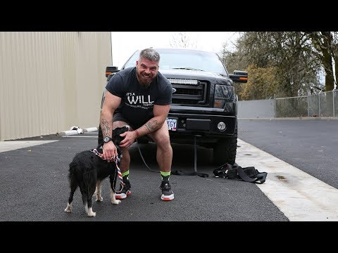 Man pulls 5,000 lb. truck with a dog leash!?
