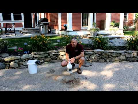 Muriatic acid removing a rust stain From concrete 1