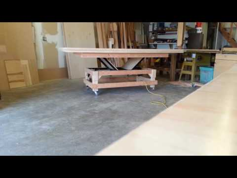 Multiple sheet plywood lift using a trashed hospital bed.