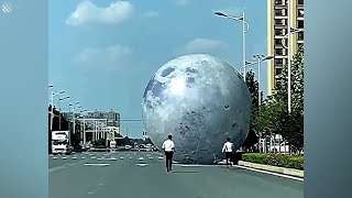 Workers chase after GIANT moon balloon blown away by strong winds