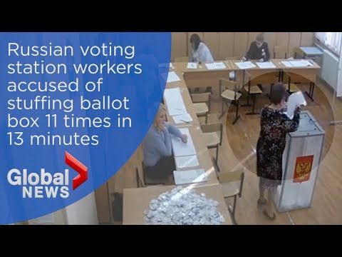 Russian election: CCTV appears to show polling station workers stuffing ballot box