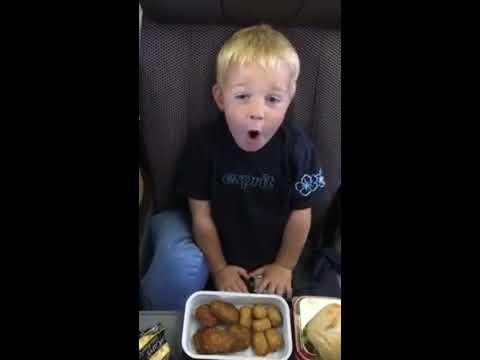 Funny young boy excited for food Qantas Sydney Australia to Hawaii