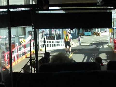 A BC Ferries ship docks at Departure Bay & bus exits car deck for Nanaimo 2010-09-07