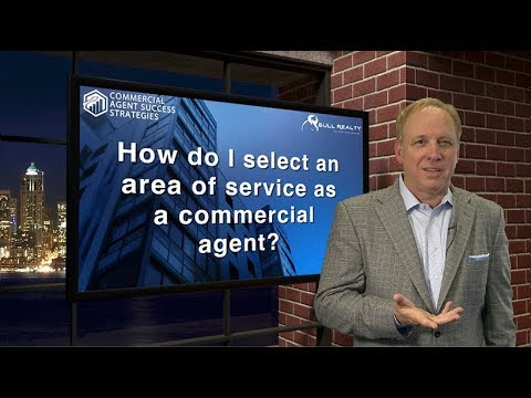 How do I select an area of service as a commercial agent?