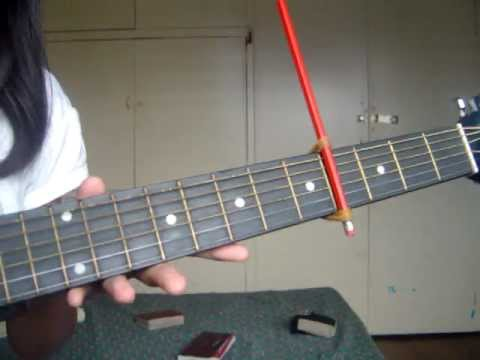 How to make a capo using a pencil and 2 rubberbands!! the easiest way!!
