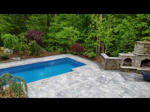 Outdoor living fabulously around a LEISURE ELEGANCE FIBERGLASS POOL by Preferred Properties Lsc