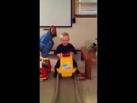 Eli riding roller coaster