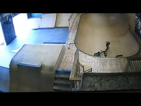 KID TRIES TO GET OUT OF HALF PIPE FAIL CAUGHT ON SECURITY CAMERA!!