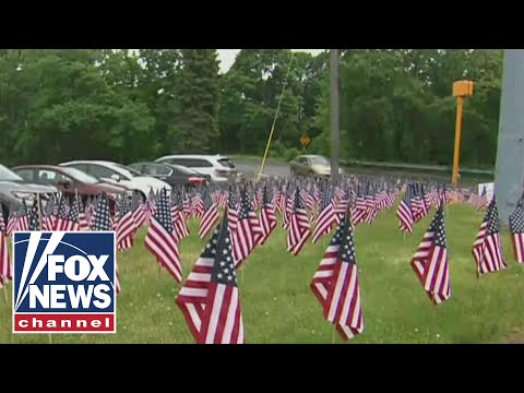 City tells business to remove 'excessive' American flags
