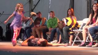 Hypnotist Marc Savard performs with his daughters in hypnosis show