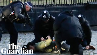 Armed police detain man after incident at parliament
