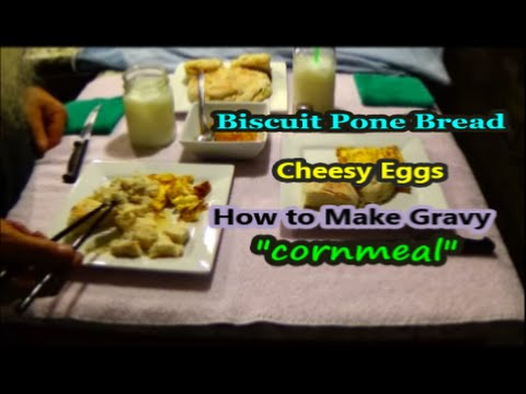 Homemade Gravy  cheesy eggs  biscuit bread
