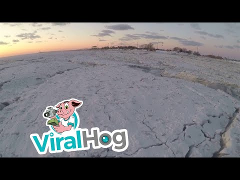 Walking Across Frozen Cape May Canal || ViralHog