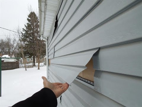 Super loose siding at a St Paul, MN Home Inspection